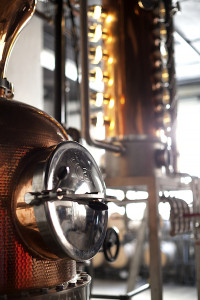 """At the tiny Port Morris Distillery in the Bronx, along the far wall between two long shelving units laden with barrels, hangs a rolled-up piece of olive drab cloth.When it's unfurled, it reveals itself to be a hammock. This is where """"Tio"""" Rafael Rodriguez, the company's Puerto Rico-born master distiller, rocks back and forth, thinking great thoughts as he waits for another batch of PMD's chief product to make its way through the 105-gallon German-made combination pot-column still. The product is pitorro, a form of moonshine that is widespread in Puerto Rico but little known outside that island commonwealth. PMD's version, released in both a clear and a barrel-aged expression, is the first example to be commercially produced in the United States. That Rodriguez is comfortable while working is important. For he is the man who holds the recipe in his head, and he moved from Guayama, Puerto Rico, to New York to help his nephews, Jerry and Ralph Barbosa, launch their liquor concern. """"My uncle brought the recipe from Puerto Rico four or five years ago,"""" said Ralph. """"It's an old family recipe. He's been moonshining since he was about 16. At 19, he branched off in his town and started created his own recipes."""" It's not unusual that the Barbosas should have a pitorro formula in the family. In Puerto Rico, homemade moonshine is as common as sweet tea on verandas below the Mason-Dixon Line. """"Listen, in Puerto Rico, if you go to someone'shouse, there's no Bacardi,"""" explained Ralph. """"Everyone's always going to offer you pitorro. There's going to be a moment where they'll say, 'I'll be right back.' Then they're going to go into the back somewhere and come back with a jug."""" The company has been at its location on East 133rd Street since 2011 — it's a lonely industrial neighborhood, but not that lonely: The Tirado Distillery and Bronx Brewery are nearby. But it spent the next two years securing its distilling license. It labeled its first bottles as rum, """"not knowing that when you """