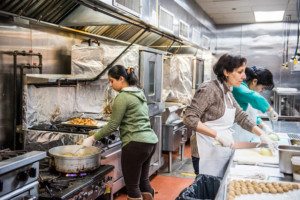 Eat Offbeat - Dhuha, bahia and lauren working in the kitchen together.