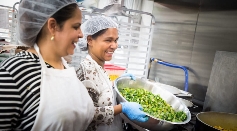 2017-08-07-MAN-tiffin-chef-surbhi-sahni-and-subera-prepping-okra-photo-by-donnelly-marks